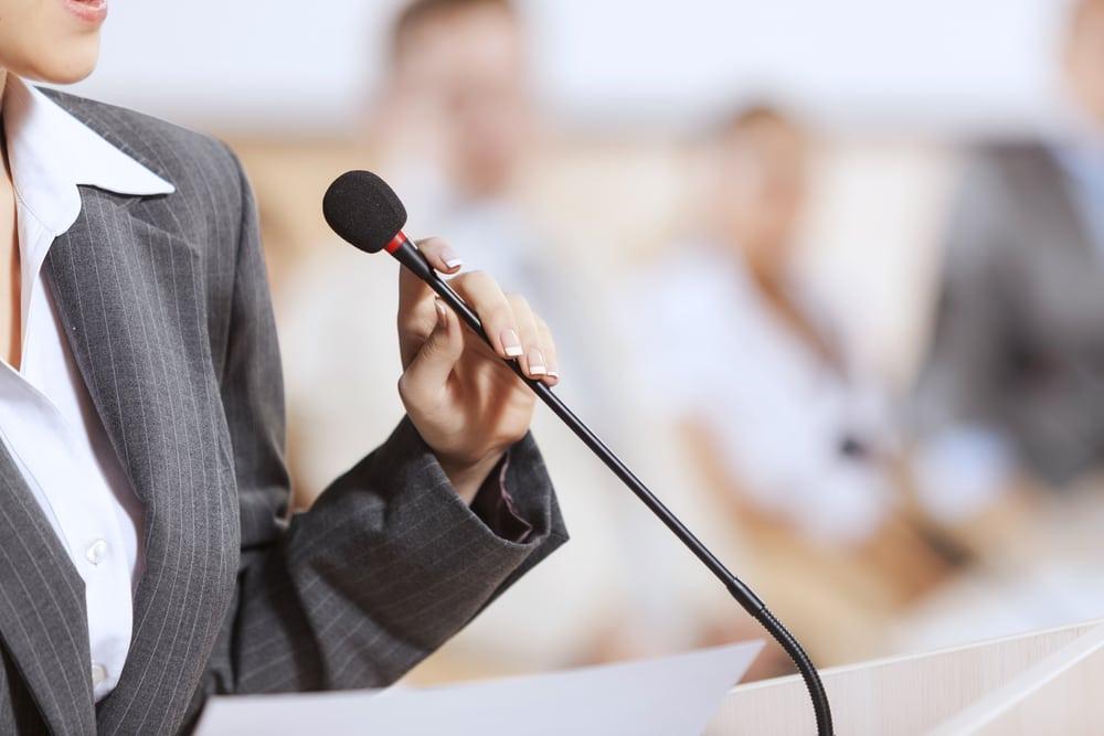 woman, holding mic
