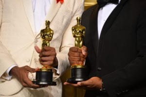oscars winners holding trophies