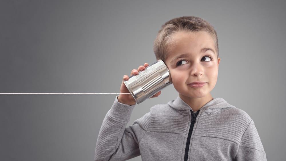 kid listening through can