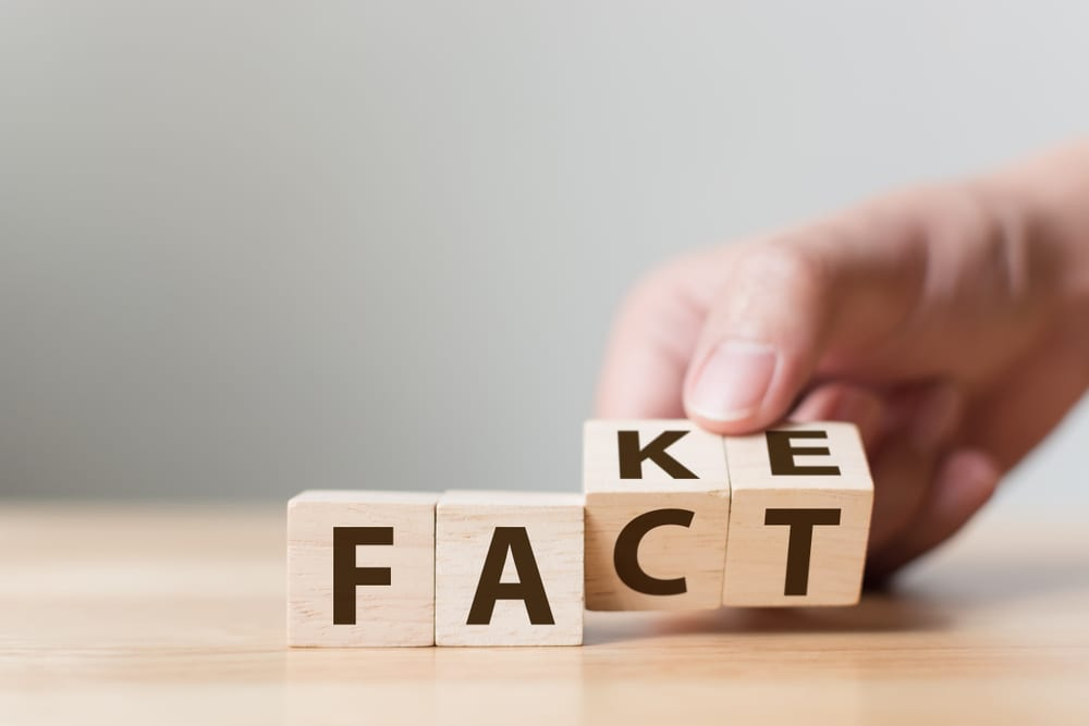 "hand fixing fake blocks to ""fact"""