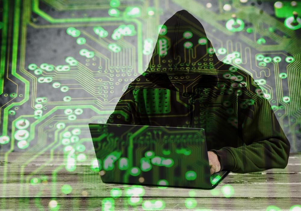 hacker with cybersecurity code overlay