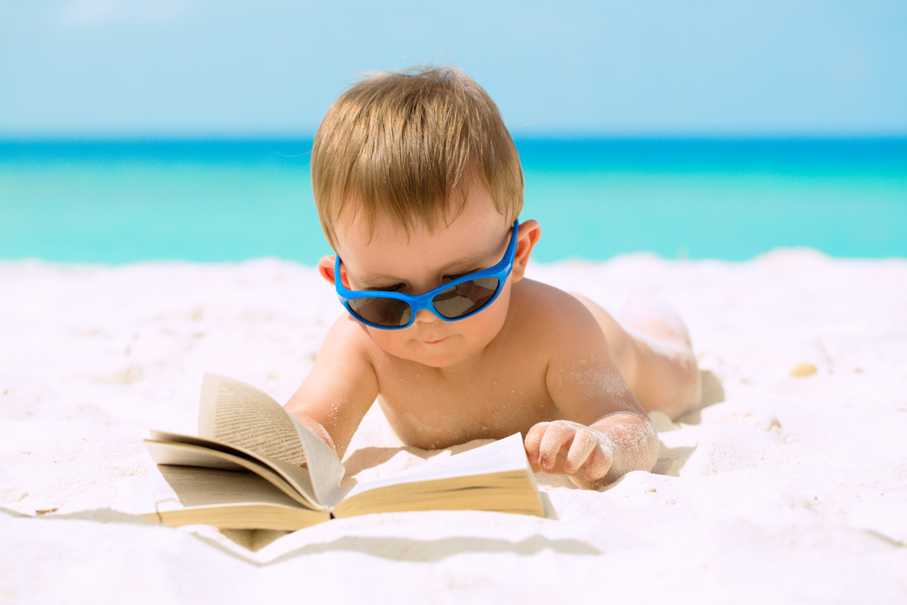 a small child beach reading