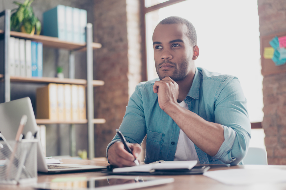 businessman questioning decision at work