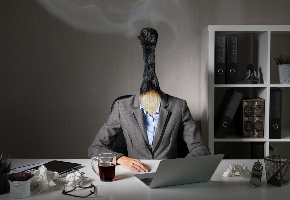 executive with burnt match for head