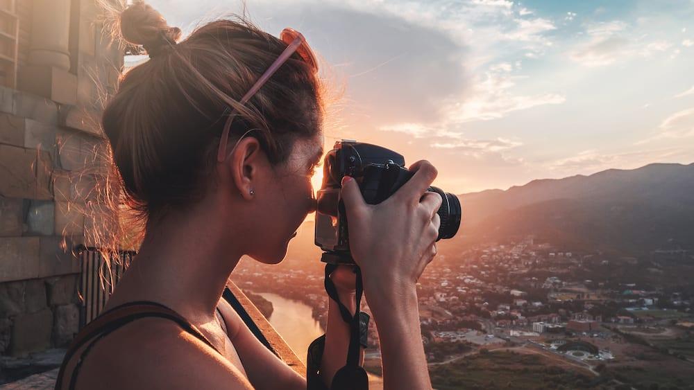 photographer behind camera