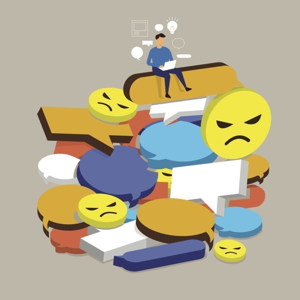 social media crisis, angry comments, man sitting with laptop on top of angry emojis